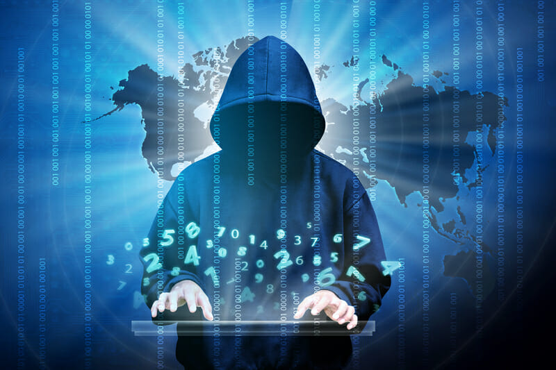 Computer hacker silhouette of hooded man